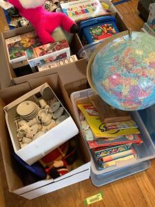 Globe, legos, stuffed bull, booster seat, flash cards, puzzles