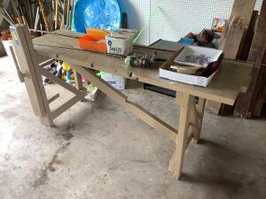 Fishing table-Two Zebco rods w reels, one Zebco reel, bamboo pole, bait box, tackle box and ashtrays Table measures 73 x 23 x 32