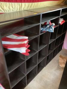 Three piece particle board shelf unit, two US flags and an Iowa flag Each shelf unit measures 24 x 12 x 48