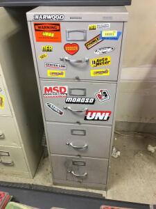 Four drawer legal size file cabinet and contents which include car related items- Cabinet measures 18 x 29 x 52