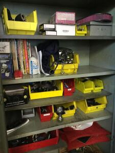 Contents of cabinet-tachometer, ball, Ford emblem, car related books and more