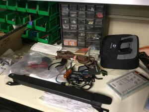 Items on top of desk-bins and contents, trig tables, Stanley utility blades, and more