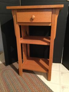 "Oak side table with drawer. Measures 30"" H x 17"" W x 19"" L"
