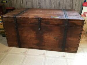 Antique pine trunk measures 20 x 35 x 17 tall. It has hand wrought iron handles on each end. The hardware is all hand-wrought, dovetailed corners and it looks like the top is put together with wooden pegs rather than nails