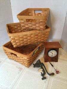 Three modern nesting baskets, a miniature meat grinder and a Schlabaugh and Sons cherry mission style shelf clock