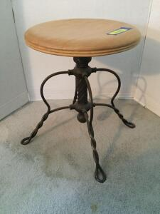 "Antique piano stool with twisted wrought iron legs 15"" round, 18""H at its lowest position"