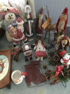 Decorator Christmas figurines-some carved wood and some ceramic, a little pine sled sleigh, tin cut-out boots, plush snowman