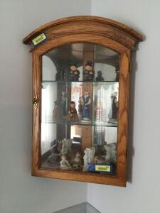 "Hanging corner curio cabinet with glass shelves and mirrored back. Measures 10""D and 18"" across the front. *No contents*"