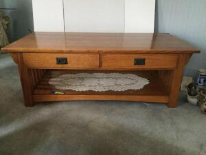 Mission style oak coffee table with two drawers measures 24 x 48 x 17 tall