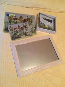 One pair of bird house motif glass cutting boards, an Angelic photo album NIB and a bleached oak framed wall mirror