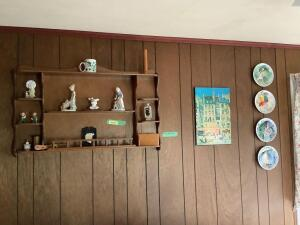 Four Paul Durant collector plates, wall art, shelf with figurines and other decorative pieces Shelf measures 40 x 24