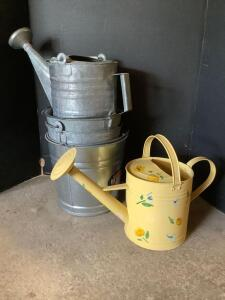 Galvanized buckets, galvanized water can and a pretty yellow watering can