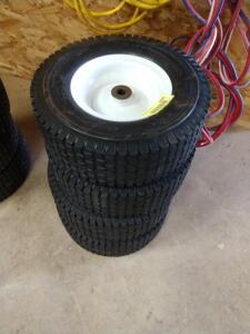 4 new 13 by 5.00 - 6 tires and rims