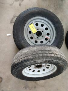 3 trailer tires on 5-hole rims ones brand new with the label still on the other two are both used one in very poor shape one Fair