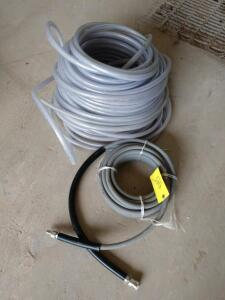 Large coil of half inch ID 200 PSI braided clear hose and a heavy duty pressure washer hose with SNAP couplings