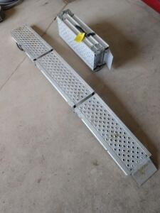 9 inch wide by 6 ft long triple folding ATV ramps made by Erickson no capacity listed on the tag