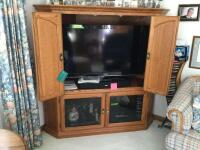 Mapleton brand oak veneer corner entertainment center. Contents on and in are excluded. Measures approximately 5' x 5'. - 2