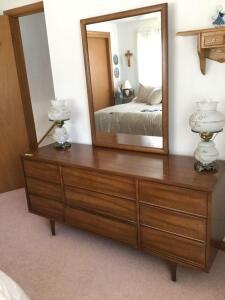 "Harmony House 9-drawer mid century modern dresser with mirror. Measures 63"" L x 19"" W x 29"" H. Mirror adds 40"" to height. *Two pieces for easy moving* Lamps excluded."