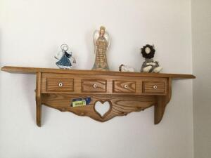 "Oak 4-drawer shelf with decor items. Shelf measures 36"" L"