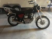 1980 Yamaha motorcycle 250 street bike, runs but needs a battery and tune up, has new tires