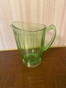 "7"" green depression glass pitcher, handle has a concealed crack"