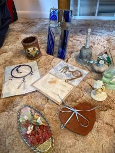 Small stain glass, dream catchers, light house bell, figurines