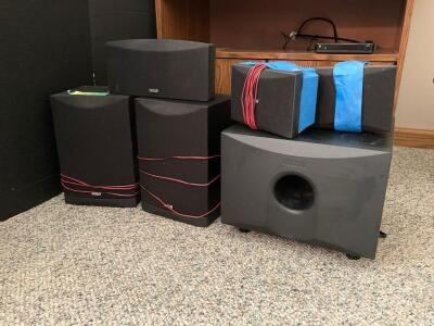 RCA surround sound set up- center speaker, pair of main speakers, pair of surround speakers and subwoofer model SP2051AW. Also included is a double door entertainment cabinet that measures 30 x 17 x 26.