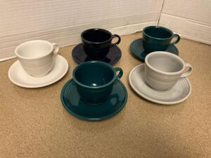Five Fiesta cups and saucers. Used as everyday dishes.