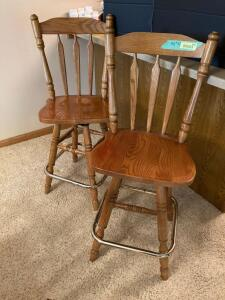 "Oak swivel 42"" bar stools w two sets of seat cushions. Some discoloration on the seats from cushions."