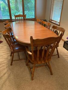 Keller oak dining table w three leaves and eight chairs (two captains). Table measures 60 x 41 x 30, each leaf is 11.""