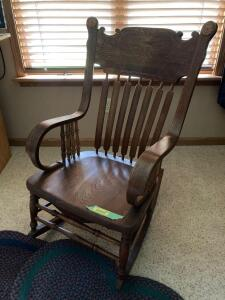 Detailed walnut? rocker with two woven rugs. See photos for damage.