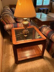 Glass topped side table with lamp. End table measures 26 x 26 x20.