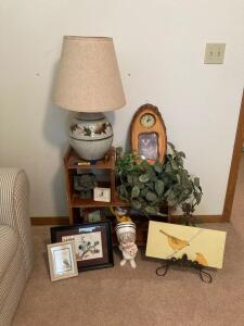 Lamp w pottery base, shelf, wall art, artificial plant, gargoyle and ceramic ladies.