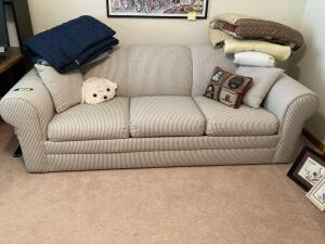 7' three cushion sleeper sofa and linens. Some wear and tear. See photos.