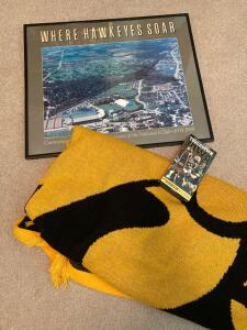 "Touchdown Iowa VHS tape, Hawkeye lap blanket measures 4' square, ""Where Hawkeyes Soar"" framed poster and Hancher Auditorium poster."
