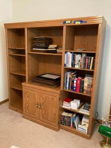 Modern oak wall unit/media center. Measures 72 x 20 x 72. Has lower double door storage and adjustable shelves. Bring tools to dismantle-appears to be one piece. *No contents*