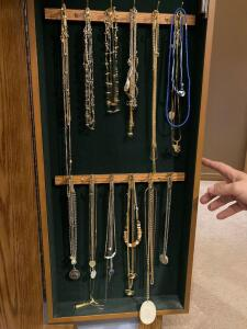 Costume jewelry in right door and bottom four drawers of jewelry armoire. Includes LINDE STAR SAPPHIRE ring.