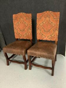 Pair of straight back pleather padded sitting chairs