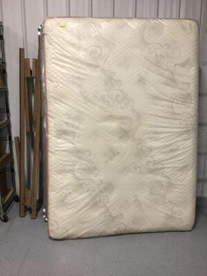 Lebeda full size mattress and box spring with metal bed frame. Appears to have been in cover for its whole life