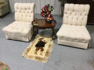 Two straight back padded chairs, side table w glass top serving tray, floral decor and the Pied Piper (appears to be made of pelts). One chair has a few spots.