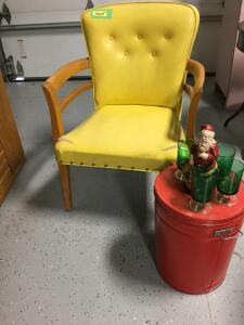 Vintage vinyl arm chair with a red popcorn can and Santa with his green drinking glasses