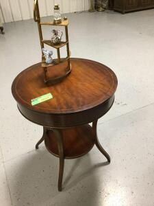 "Modern round parlor table and decor Table measures 2' diameter and 28"" tall"