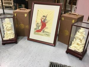 Oriental picture, possibly silk, and two carvings in glass display cubes