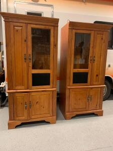 Three piece lighted media cabinet Cabinets measure 34 x 22 x 76,  Each cabinet has pull out storage, three adjustable shelves on top, an adjustable shelf on the bottom and a slide out drawer on the bottom. Minor damage to front of cabinet, see photos.