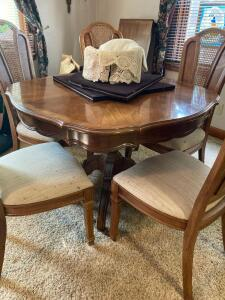 "Thomasville modern dining table with 6 chairs (2 are captains) and two 20"" leaves. Table measures 44 x 30. Also included are table pads and two legs for support when table is extended"