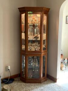 Modern oak lighted corner curio cabinet w 4 adjustable glass shelves Measures 24 x 24 x 72 *No contents*