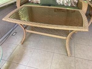 Plicker glass top patio coffee table Measures 43 x 24 x 22   **Matches pieces in Lots 9049-9052**