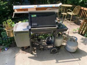 Weber three burner propane grill, Weber barbecue rotisserie and two tanks (one partial, one empty)