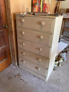 Five drawer dresser and contents-axe, yard tools, pruners, etc Dresser measures 26 x 16 x 42