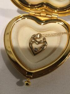 Diamond Mother with child necklace in a heart shaped compact